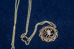 Helen Paddle jewelry gold chain with  Scorpio charm - for Julie Hall?
