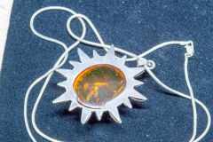 Helen Paddle jewelry silver necklace with sun shaped pendant amber