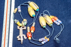 Helen Paddle jewelry necklace handmade beads with cloth rope and alligator pendant Africa?