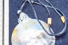 Helen Paddle jewelry necklaace cord with mother of pearl large medallion