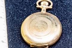 Helen Paddle jewelry gold pocket watch there's a great chain on the Uncle Mac locket Jake Patti Loach giving back to the estate